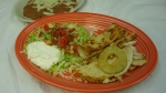 Quesadillas Hawaianas - Two small quesadillas filled with grilled chicken, pineapple, onions, and cheese. Served with lettuce, guacamole, pico de gallo, sour cream and your choice of rice or beans.